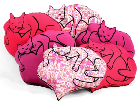 pile of heart cat pillows