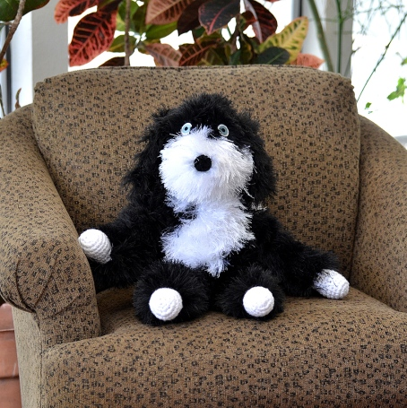 black white fluff cro dog chair